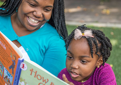 "Elaine reads ""How a Seed Grows"" to her bright and curious daughter."