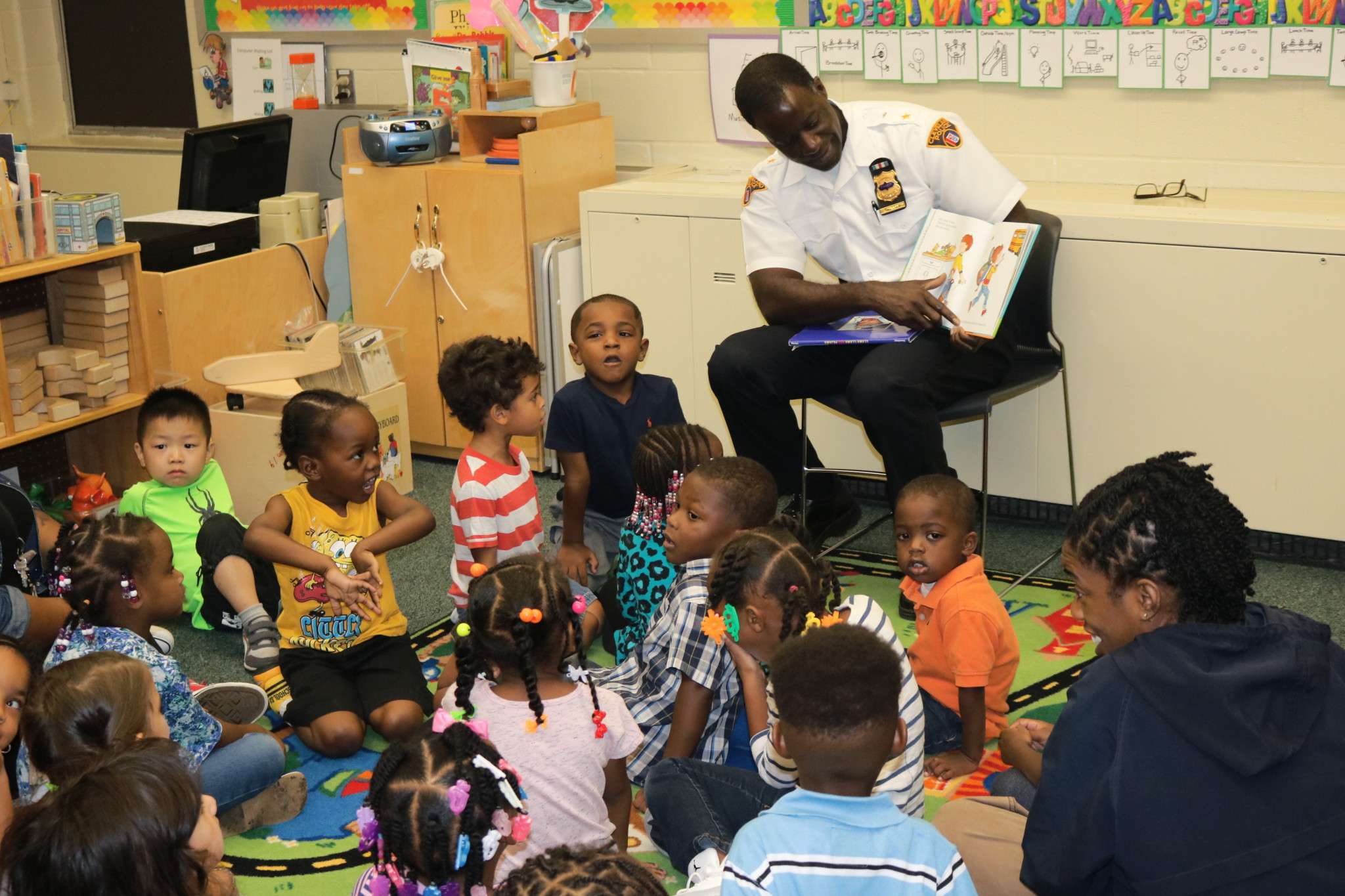 Cleveland Police Chief Calvin Williams reads to Head Start students as part of Friendship through Reading program