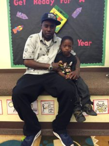 4-year-old Darrion sits with his dad, Will, at the 2016 Fathers Walk
