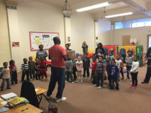Children's author Floyd Stokes read and sang to students at the Villa Head Start center