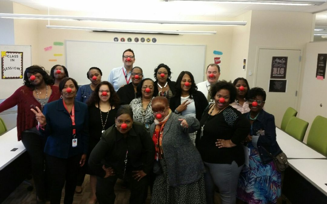 Council's Neighborhood Opportunity Center staff members celebrate Red Nose Day