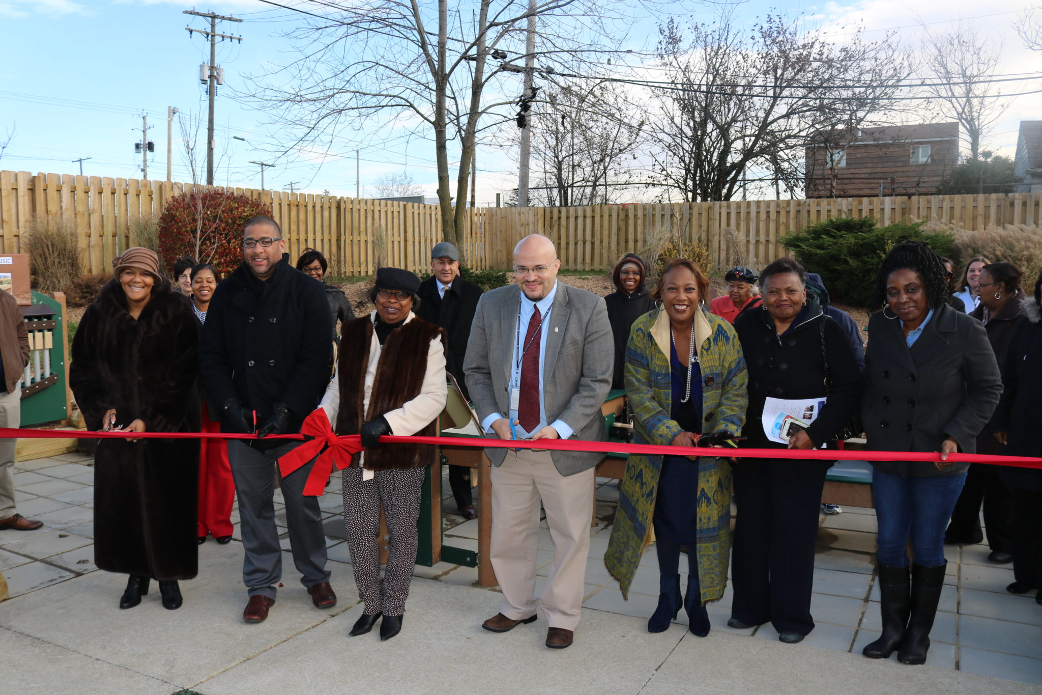 CEOGC staff, board members and community partners cut the ribbon to officially open the certified outdoor classroom