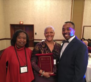 CEOGC's Dr. Thea Wilson and Dr. Jacklyn A. Chisholm joined CPD's Detective Reginald Lanton to accept the Exemplary Program Award.